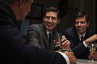 men-talking-in-bar